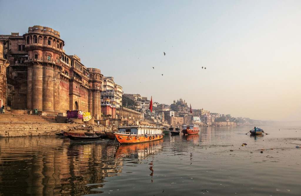 Life Along The Ganges (ganga) River.pilgrims Bath And Pray, People Walk,washes And Dry Laundry.tourists Take Boat To Sea Old Temples And Ghats From The River